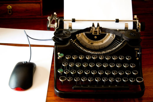 Old style typewriter with modern mouse